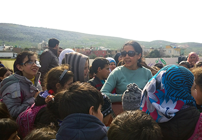 Singing with the school kids, hills of Syria in the background.