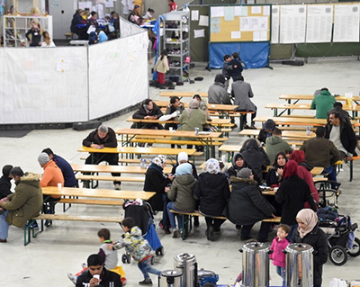 refugees at tables